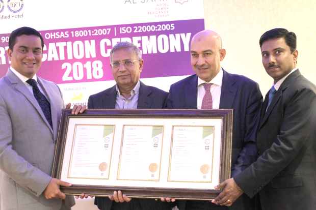 <p>Above, from left, Mr Aarif, Mr Zafer, Saeed Hamam and K C Rajesh with the certification.</p>