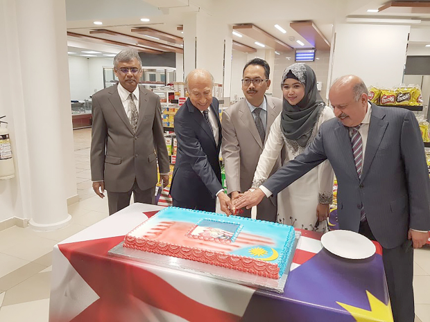<p>The Malaysian Embassy organised an event to mark Malaysia Week. A range of activities have been lined up until Saturday. Ambassador Agus Salim Bin Yusof attended the cake-cutting ceremony at Al Jazeera Supermarket, Zinj. Above, at the cake-cutting event are, from left, Al Jazeera Group general manager Ujjal Mukhajee, Al Jazeera Group chairman Abdulhussain Dawani, Mr Yusof, Mr Yusof's wife Norsyazwani Hamdan and Al Jazeera Group director Abdulhameed Dawani.</p>