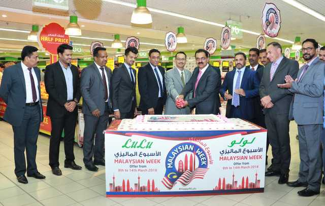 """<div>Officials cutting a cake to mark the inauguration of Malaysia Week.</div><div><br></div><div><br></div><div><div>Malaysian Ambassador Agus Salim bin Yusof inaugurated Malaysia Week at Lulu Hypermarket in Dana Mall yesterday. The promotion runs in all the branches of the hypermarket until Wednesday and will showcase an extensive range of products from Malaysia – fruits and vegetables, grocery and furniture. Present at the event were senior management of the hypermarket led by director for Bahrain and Egypt Juzer Rupawala. """"Lulu Hypermarket has a big footprint in Malaysia as a source of many products and also a popular hypermarket in Kuala Lumpur,"""" he said. The ambassador also inaugurated the week at Swiss-Belhotel Seef yesterday. The festival will continue until Saturday. Above, the Malaysian Ambassador inaugurates the week. Left, top officials at the event.</div></div>"""