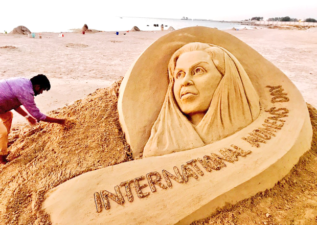<p><em>Mr Pattnaik working on the sculpture</em></p>