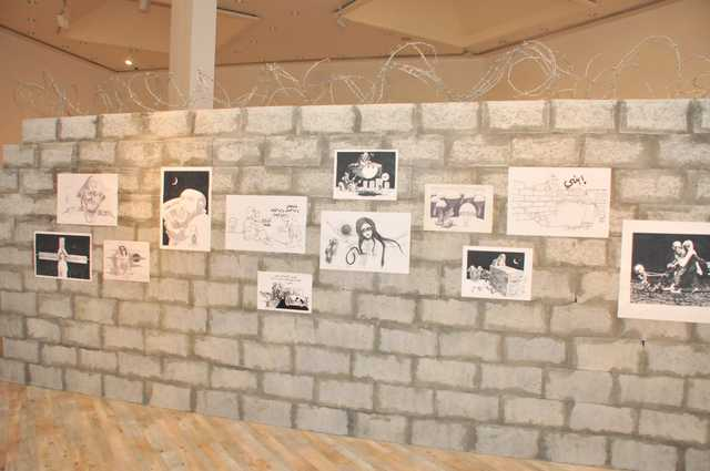 <p>Works by the late iconic Palestinian cartoonist Naji Al Ali went on display in Bahrain for the first time as part of the Spring of Culture festival. The exhibition, 'This Compass Will Always Point To Palestine', at the Art Centre near Bahrain National Museum focuses on Jerusalem as the permanent capital of Islamic culture. The cartoons tell the story of the occupation of Palestine and Jerusalem from the beginning of Mr Al Ali's career until his assassination in London in 1987. The exhibition is open daily from 8am to 8pm until March 31. Above, some of the cartoons on display on a concrete wall topped with barbed wire.</p>