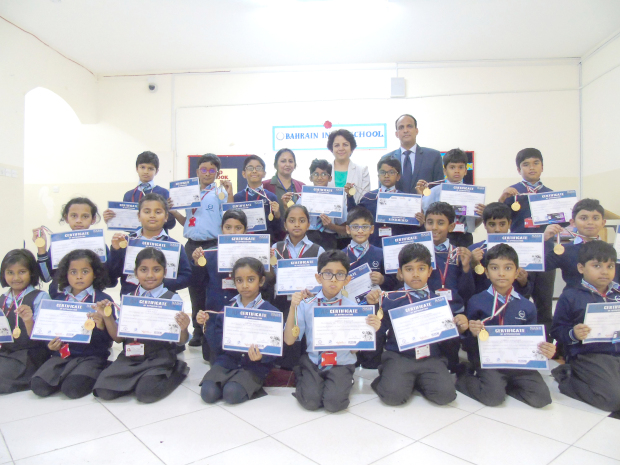 <p>Hundreds of Bahrain Indian School (BIS) students were awarded for their excellence in different inter-school, inter-house and external examinations. Prizes and certificates were awarded at the ceremony to nearly 300 students from grades one to eight at the BIS campus in Budaiya in the presence of teachers and parents. School director Himanshu Verma and his wife Ritu Verma congratulated the winners on the occasion. Above, some of the students holding up the medals and certificates they received.</p>