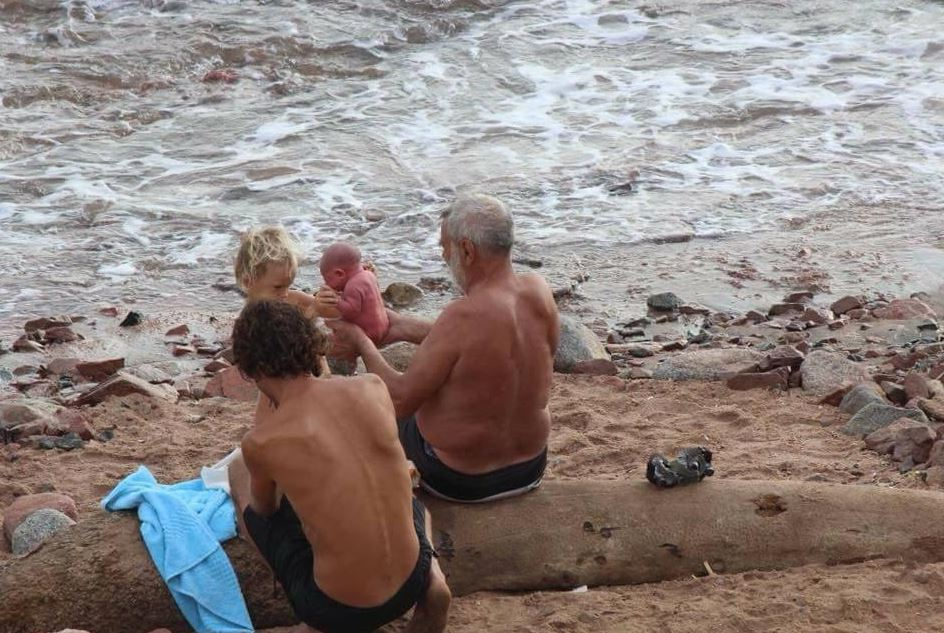 Russian woman gives birth in the sea