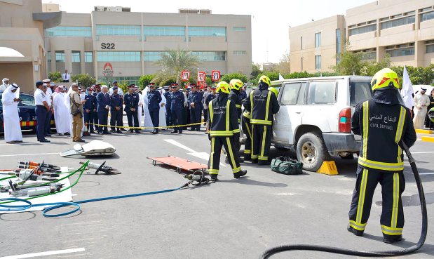<p>A demonstration of emergency responses was held at Bahrain University to mark the Fifth Traffic Forum. The event was inaugurated by Interior Ministry Deputy Inspector General Major General Shaikh Khalifa bin Ahmed Al Khalifa in the presence of university president Dr Riyadh Hamza and members of the Civil Defence. It featured a photography exhibition, old cars on display in addition to tips on rescuing traffic accident victims. Above, emergency response exercises being demonstrated by Civil Defence personnel.</p>