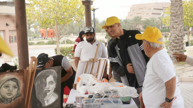<p>Paintings on sale at the market.</p>