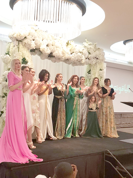 Lights, Camera, Fashion Academy co-founder Hamra Alam, fourth from right, with participating models