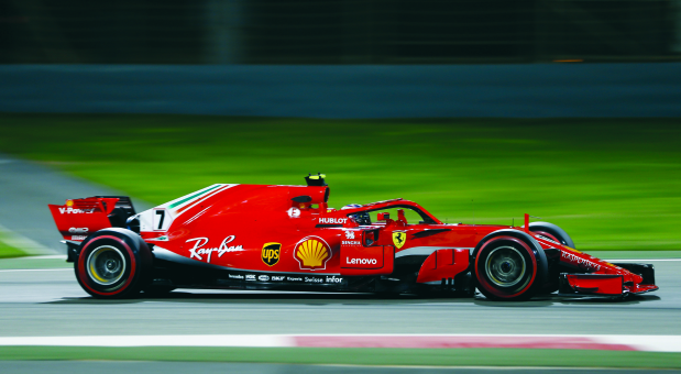 Ferrari's Raikkonen and Vettel set early pace