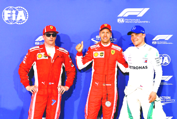 Vettel storms to pole