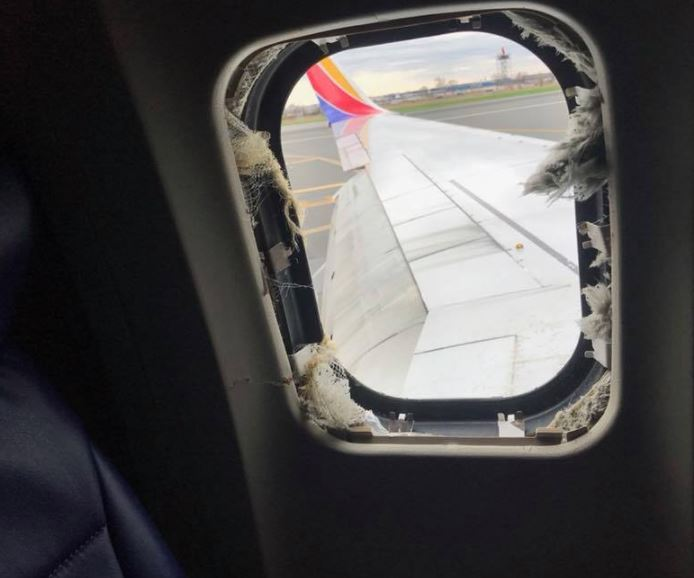 Woman fatally injured after being almost sucked out of airplane window