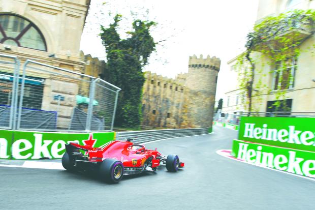 Vettel tames Hamilton for Baku pole