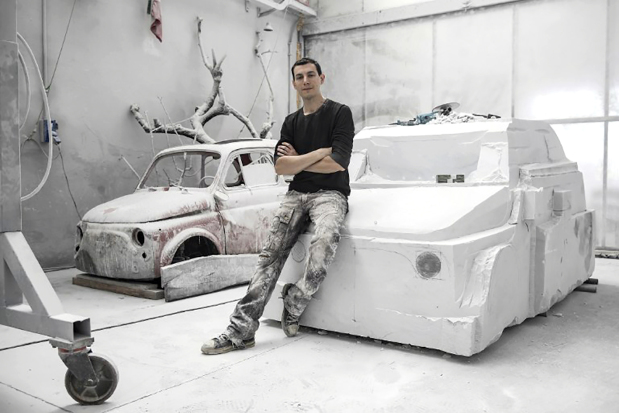 Artist sculpts car out of marble...
