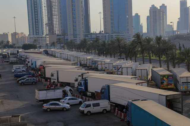 Clamp on large trucks selling food items in Manama Central Market car park