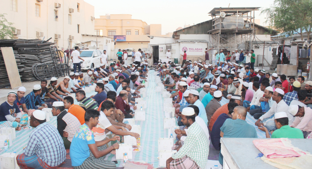 <p>Malabar Gold and Diamonds distributed 1,400 Iftar kits at labour camps around Bahrain. The prominent jewellery retailer is planning to provide a total of 5,250 Iftar meals to workers at labour camps in Askar, Eker, Jaw, Arad and Hidd, among others. The initiative will be carried out as part of the company's corporate social responsibility, in association with Discover Islam, Al Hedaya Centre, Friendship Society for the Blind and UCO Parents Care. The firm is distributing more than 70,000 special Iftar meals/kits across the GCC and Far East during Ramadan this year. Workers at a labour camp having Iftar</p>