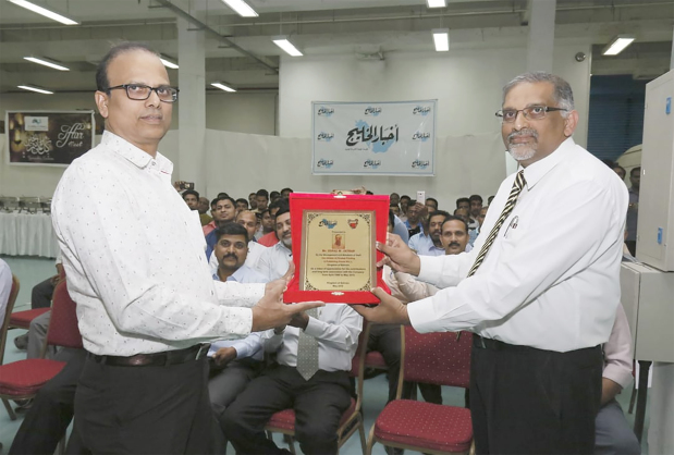<p>Dar Akhbar Al Khaleej Press and Publishing House hosted an Iftar banquet for its employees at its premises in Sanad yesterday. Operations Manager Samuel Paul honoured Gopal Jathan, who is retiring as a supervisor after 30 years of service in the printing division. Above, Mr Paul, right, presents Mr Jathan with a memento.</p>