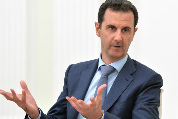 Syria's Assad threatens force against US-backed Kurds