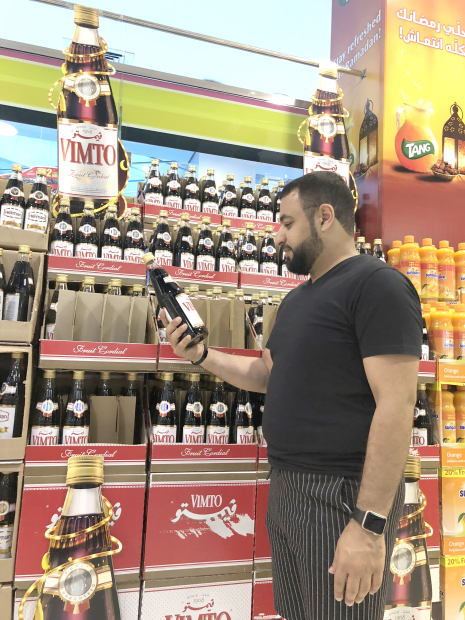 <p><em>A customer reaching out for a Vimto bottle at a local supermarket. Picture: Ahmed Al Fardan</em></p> <p>Over the years, Vimto has become a dining table essential for families in Gulf countries during Ramadan.</p> <div>The sale of the British soft drink reaches an all-time high during the holy month as Vimto's high sugar content and sugar flavour works as a welcome energy boost after a day of no food or drink.</div> <div></div> <div>The drink – made from grape, blackcurrant and raspberry and flavoured with herbs and spices – is hugely popular in Bahrain and is an Iftar favourite.</div> <div></div> <div>Vimto was first introduced to the Middle East by Al Aujan family in 1928 and has been associated with Ramadan ever since.</div> <p><em><br /></em></p>