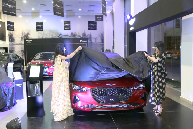 <p><em>Models unveil the car.</em></p> <p>The all-new Genesis G70 was launched by First Motors at its showroom in Ma'ameer yesterday.</p> <div>The G70 is equipped with a 2.0 turbo engine or a 3.3 V6 twin-turbo engine.</div> <div></div> <div>Ground clearance, vehicle height, rear glass angle and the height and slanting of the trunk have been fine-tuned.</div> <div></div> <div>In addition, afull lengthundercover shields the lower part of the vehicle, minimising air resistance and delivering best-in-class aerodynamic performance.</div> <div></div> <div>Drivers can choose between different driving modes and the sedan includes features such as an eight-inch touch screen display and a 15-speaker Lexicon surround-sound system. Prices for the Genesis G70 start at BD14,990.</div> <p><em><br /></em></p>