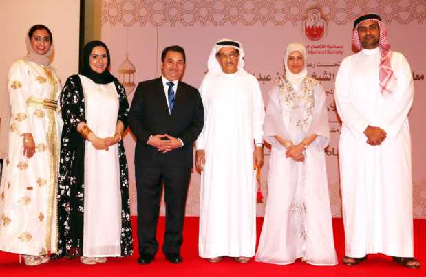 <p>Dr Shaikh Mohammed, third from right, and Dr Al Qassim, second from right, with society board members</p>