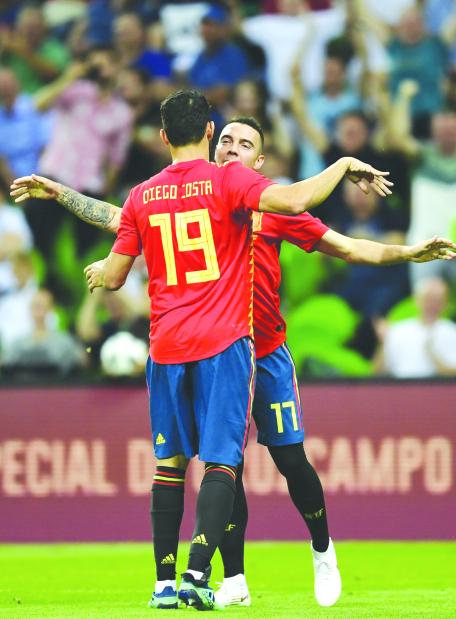 Aspas stars as Spain pip Tunisia