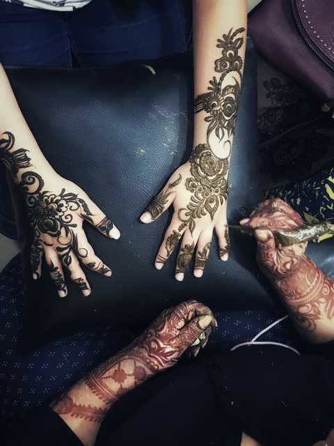 <p><em>A customer gets henna applied to her arms at Hawajer Beauty Salon in Riffa.(Picture: Reem Al Daaysi)</em></p> <p></p> <p>Women and girls are gathering at their neighbourhood beauty saloons to get their hands decorated with henna in preparation for Eid.</p> <p>Some even invite henna designers to their own homes to avoid the rush.</p> <p>Henna is a reddish-brown colouring made from a flowering plant that grows in regions of Africa and Asia.</p> <p>Since the Bronze Age, people have used dried henna ground into paste to dye skin, hair, fingernails, leather, silk and wool.</p> <p>There are many henna designs and Arabic designs are famous for their simplicity. It is applied using a henna-filled cone.</p> <p>Once the henna dries on the skin it is scraped off leaving behind a deep brown colour that stays for a few days.</p> <p><br /><br /></p>