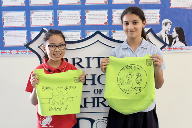 <p><em>Jennika, left, and Aliya with their green bag designs.</em></p> <p>British School of Bahrain grade six students Jennika Bangunan and Aliya Delgado have won a Green Bag competition organised by the school.</p> <div>Their designs will be printed on 1,000 bags that will be sold in the school over the coming weeks.</div> <div></div> <div>The bags have been created alongside the school's Eco-Rangers programme to help raise awareness of the use of plastic bags in Bahrain.</div> <p><em><br /></em></p> <p><em><br /></em></p>