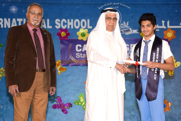 <p><em>A student receives his certificate from Mr Hasan in the presence of Mr Hulaiwah</em></p> <p>Thirty Al Noor International School students received certificates during an ICT awards ceremony held at the school's premises in Sitra.</p> <div>School chairman Ali Hasan presented the Cambridge ICT Starter Award certificates to studentsin thepresence of school director Muhammed Mashood, principal Amin Hulaiwah and other officials.</div>