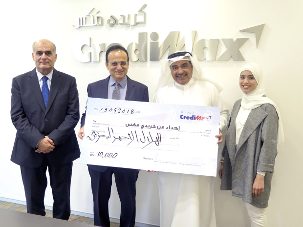 <p><em>At the presentation at CrediMax headquarters in Seef are, from left, Mr Ebrahim, Mr Mirza, Mr Al Hadi and Ms Zayer.</em></p> <p>A BD10,000 donation was presented to the Bahrain Red Crescent Society by CrediMax as part of the company's commitment to community service and support for charities.</p> <div>CrediMax chief executive Yousif Ali Mirza presented the cheque to society director general Mubarak Al Hadi in the presence of CrediMax senior manager Essa Hassan Ebrahim and society member Zainab Ali Zayer.</div> <p><em><br /></em></p>