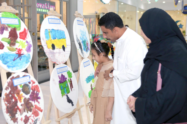 Students from various disability centres in Bahrain showcased their artwork at an exhibition as part of a programme conducted by the British Council and sponsored by HSBC Bank. 'Art-Abled' was launched in 2009 by the British Council for children with disabilities to display their capabilities and equal opportunities to contribute to the community. It consists of a series of training workshops for teachers and HSBC volunteers, followed by art workshops with the children, facilitated by specialised trainers and artists from the UK and Bahrain. The expo was held at Saar Mall. Above, visitors looking at the artwork on display.