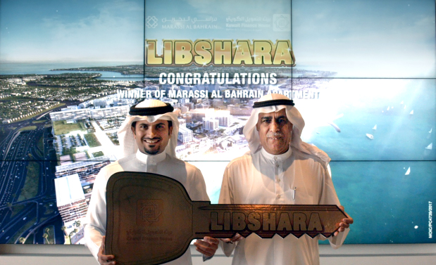 Abdulsamad Ghanim has won a luxury apartment in Marassi Residences located in Marassi Al Bahrain, as part of the fifth grand prize of KFH-Bahrain's Libshara raffle draw. The draw took place at the KFH-Bahrain headquarters in Bahrain World Trade Centre. The handover ceremony was held at the Marassi Al Bahrain sales centre in Diyar Al Muharraq, in the presence of representatives from KFH-Bahrain and Marassi Al Bahrain. Above, retail banking group deputy executive manager Subah Abdullatif Al Zayani, left, hands over the key to Mr Ghanim.