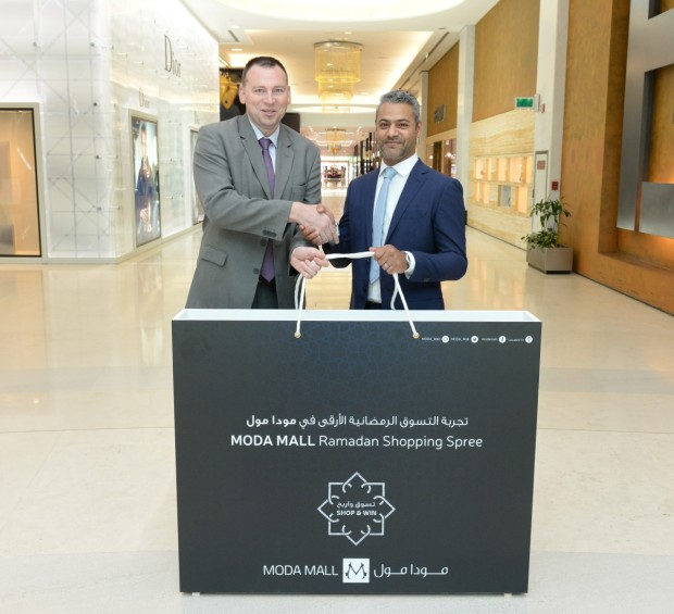<p>A BD5,000 Moda Mall gift voucher was won by Sami Matar as part of the mid-Ramadan Shop and Win campaign. Shoppers spending BD30 or more until June 20 received a raffle ticket and a chance to win shopping vouchers worth a total of BD15,000. Above, Bahrain World Trade Centre and Moda Mall's managing agent Cushman and Wakefield Bahrain's director and general manager Kelvin Crutchlow, left, presents the voucher to Mr Matar.</p>
