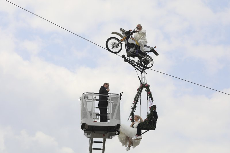 Vows in the air: German couple married in tightrope wedding