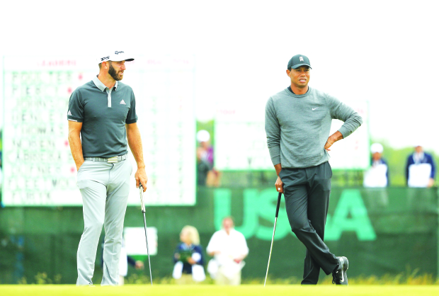 US Open golf championship: Johnson hangs on for lead