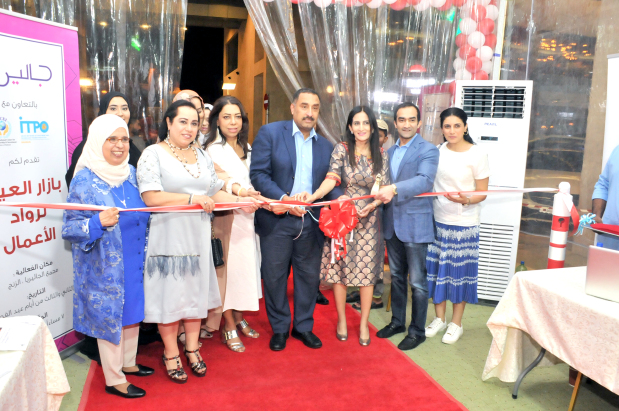 <p>Dr Hussein, centre, Ms Janahi, second from left, and Ms Dadabai, third from right, at the opening of the market. </p>