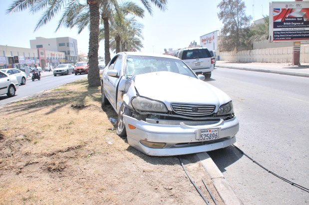 A woman was injured in a road accident on the Budaiya Highway yesterday. The incident was reported around 1pm on the highway between Shakura and Abu Saiba. According to reports, the woman lost control of the Nissan Maxima she was driving and crashed into a lamp post. She was taken to hospital in an ambulance, according to sources. Above, the car that crashed.