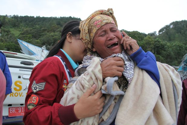 At least 128 missing after ferry sinks in Indonesia