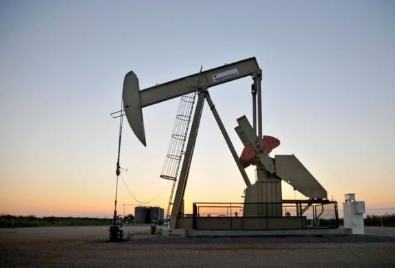 Oil prices gain on lower U.S. inventories, ahead of OPEC meeting