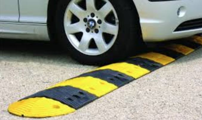Clamp on illegal road humps