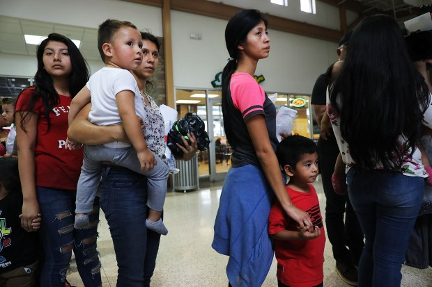 Parted at US border by Trump policy, migrants seek their children