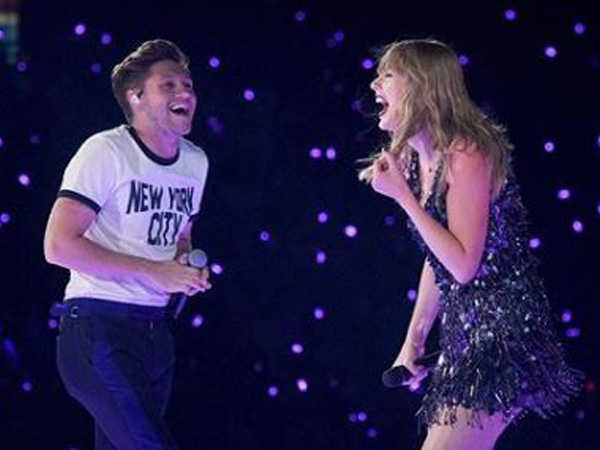 Niall Horan shares stage with Taylor Swift