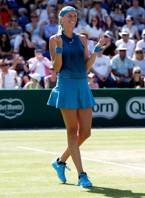 Kvitova tames Rybarikova to retain crown
