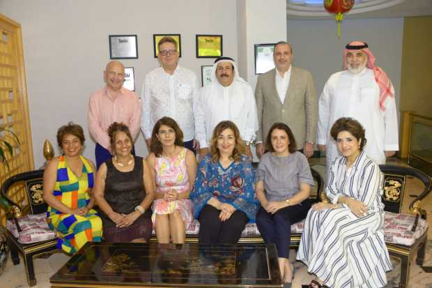 <p><em>Dr Alumran, standing, centre, with Mr Simms-Protz, standing, second from left, and guests at the luncheon.</em></p>