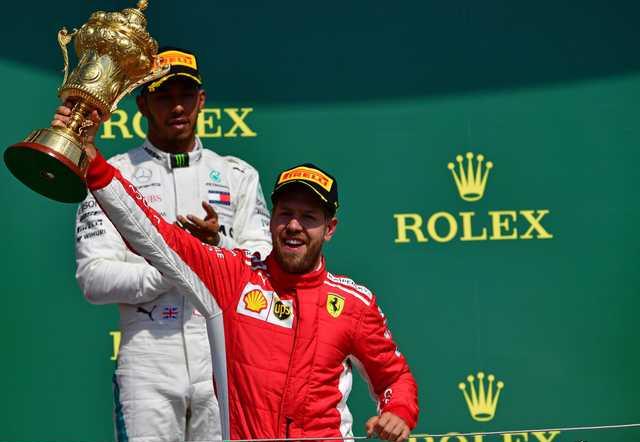 Vettel edges Hamilton to win British Grand Prix