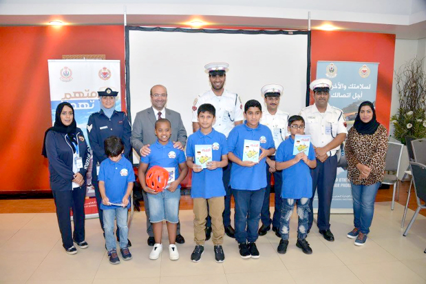 <p>An event aimed at raising traffic awareness was organised for participants in Gulf Petrochemcial Industries Company's (GPIC) annual summer camp. A team from the General Directorate of Traffic visited the GPIC headquarters and briefed children on a set of traffic guidelines that they should observe on the road for their safety. They also learned about road signs that regulate the movement of vehicles and pedestrians. Above, GPIC corporate communications manager and social activities committee chairman Zuhair Tawfiqi, back row, third from left, with participants, traffic and other officials.</p>