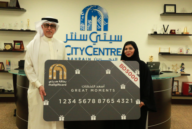 <p>Moozah Alqasami won a BD5,000 gift voucher to spend at City Centre Bahrain. She took part in the mall's FIFA World Cup promotion, in which shoppers were entered into a draw for every BD30 spent. Those who bought sports goods have double the chance of winning. A total of four draws are taking place, one a week, until July 14. Above, City Centre Bahrain senior mall manager Duaij Al Rumaihi presents Ms Alqasami with her prize.</p>