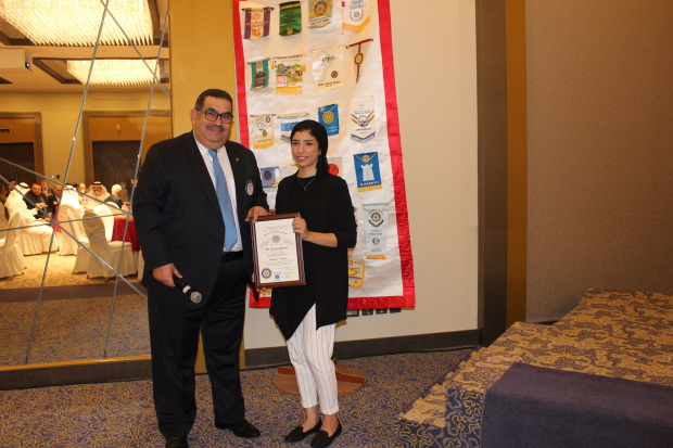 <p>Club vice-president Osama Muein presents a memento to Ms Hashem</p>