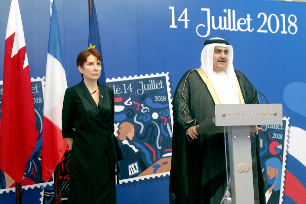 Shaikh Khalid addresses guests watched by Ms Longé.