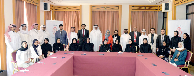 <p><em>The interns with bank first deputy chief executive Anwar Murad, Ms Al Balooshi and other officials</em></p>