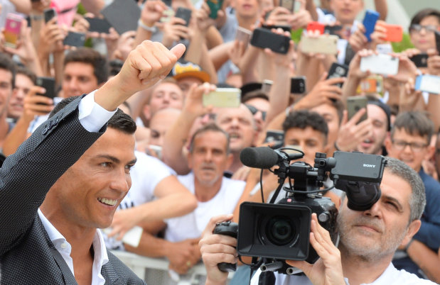 Football: IN PICTURES: Ronaldo targets Champions League glory at new club Juventus