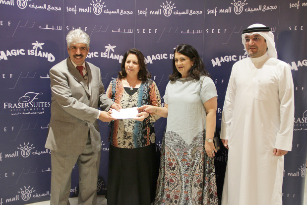 <p><em>Dr Al Sayed, left, presenting the cheque to Ms Al Balooshi and Ms Al Mosawi in the presence of Seef Properties chief executive Ahmed Yusuf.</em></p>