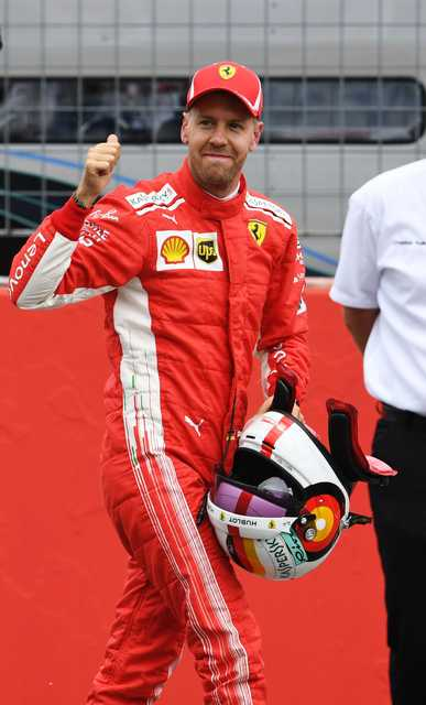 Vettel grabs pole at home